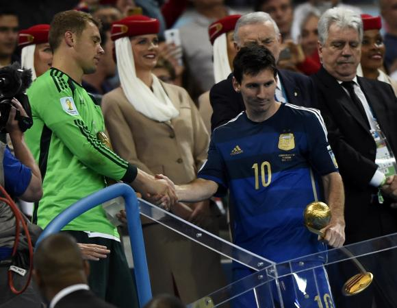 Golden Glove winner Germany's Neuer congratulates Golden Ball winner Argentina's Messi after their 2014 World Cup final in Rio de Janeiro